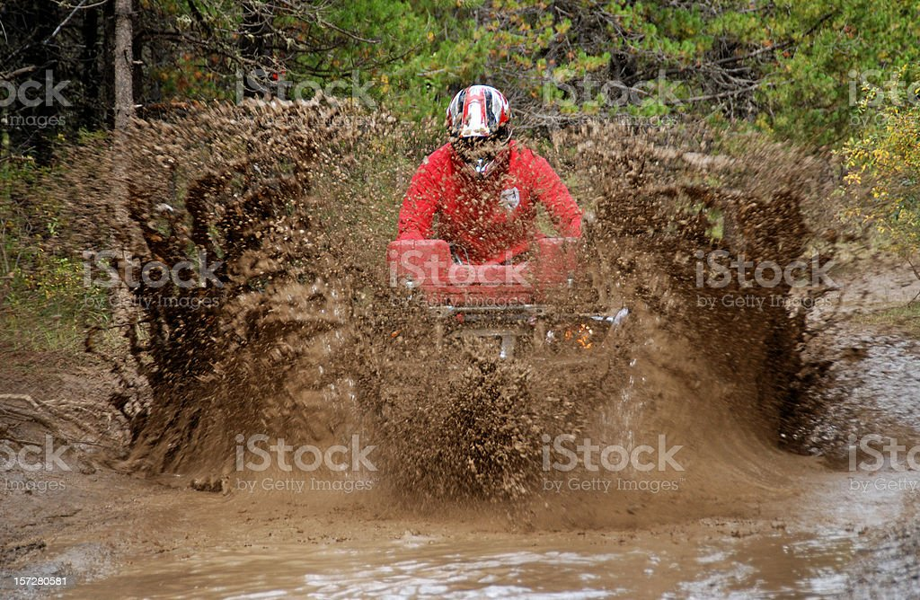 Atv in mud royalty-free stock photo
