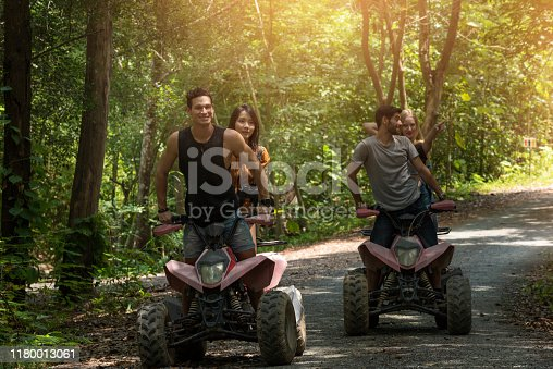 627343204 istock photo Atv riders speed race to journey through the jungle with Off-road atv car. Extreme sport is outdoor activity in the jungle. 1180013061