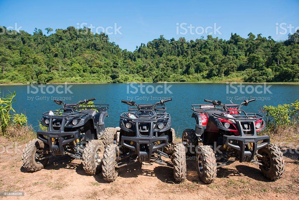 ATVs car parked lakeside stock photo