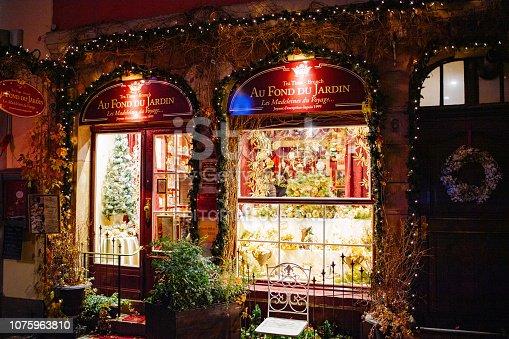 Strasbourg: Au fond du Jardin tea bar café in central Strasbourg with illuminated showcase front façade window for Christmas Holidays