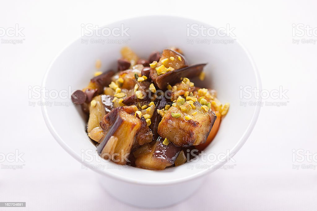 Aubergine, pistachios and chocolate chips stock photo
