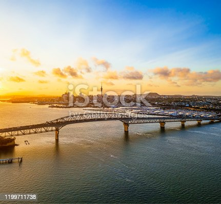 An early morning view of Auckland's city centre, seen across Waitemata Harbour and the Harbour Bridge.