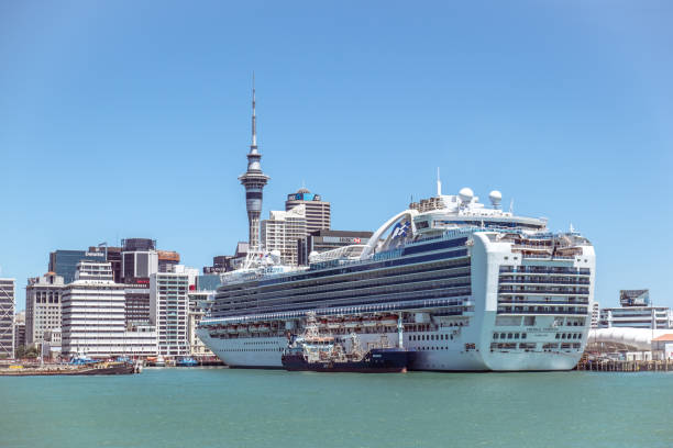 Auckland CBD skyscrapers and Sky Tower with a cruise ship in New Zealand, NZ stock photo