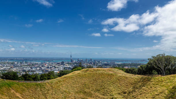 Auckland city skyline view and volcano crater of Mount Eden stock photo