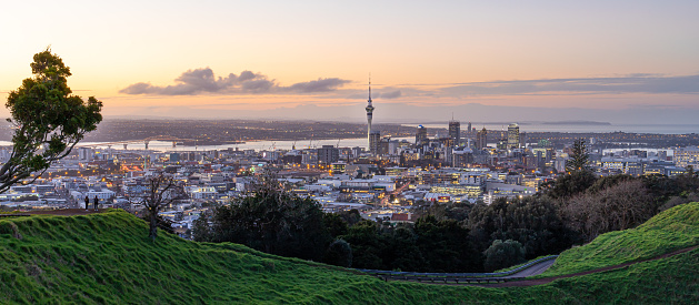 Auckland city skyline with Auckland Sky Tower from Mt. Eden at sunset New Zealand