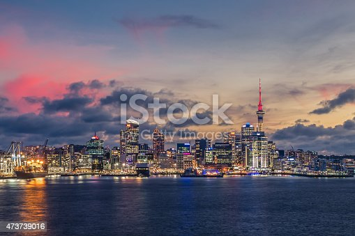 Dramatic shot of Auckland City as the sun is setting and the lights turn on.