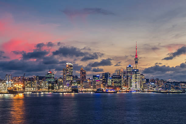 Auckland city with dramatic sunset sky stock photo