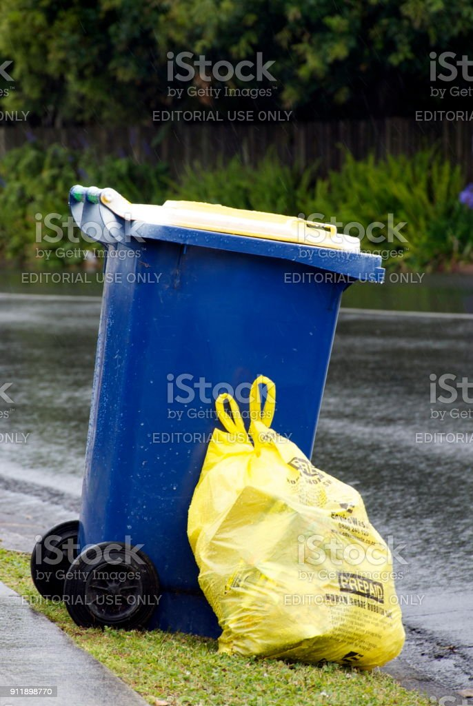Auckland Council's North Shore Rubbish Prepaid Rubbish Bag and Recycling Bin on Roadside. stock photo