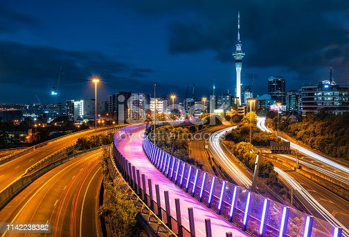 Light trails from car traffic on the highways near Auckland's city centre, and the glow from the city's elevated bicycle land and footpath.