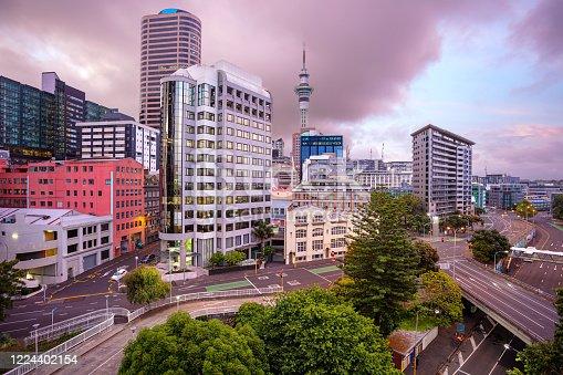 Aerial cityscape image of Auckland skyline, New Zealand during summer sunrise.