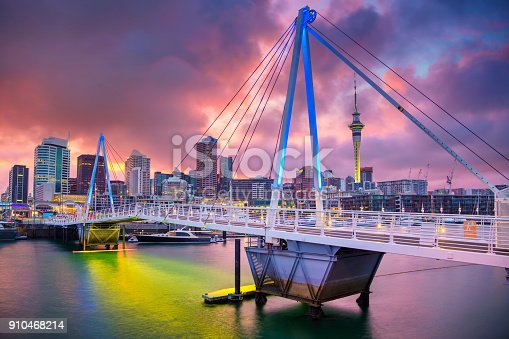 Cityscape image of Auckland skyline, New Zealand during sunrise.
