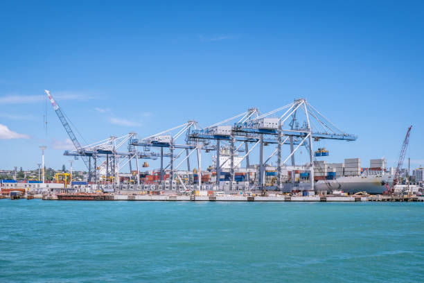Auckland port with shipping containers, cranes and ship in New Zealand, NZ stock photo