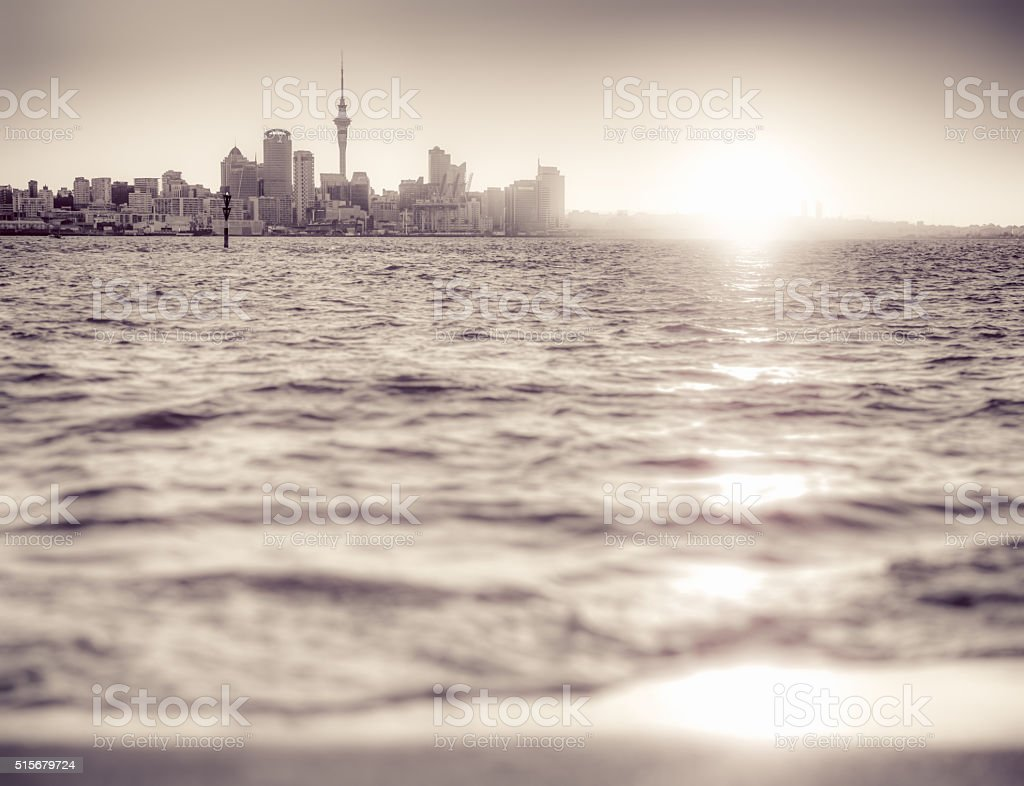 Auckland skyline at sunset - monochrome stock photo