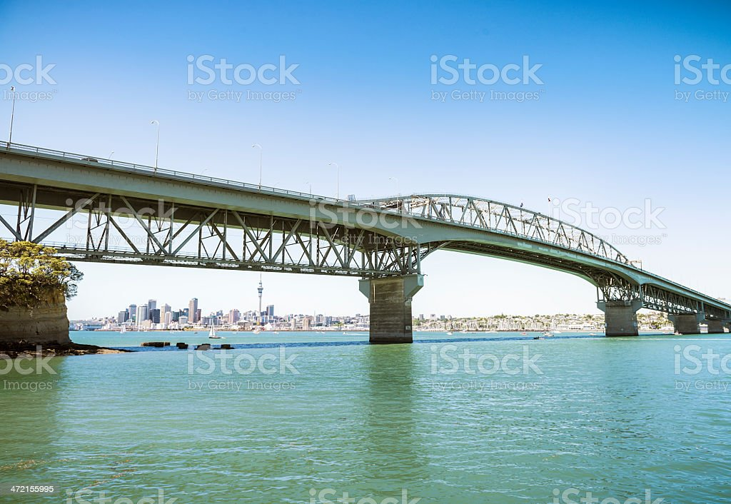 Auckland Skyline under the Harbour Bridge stock photo