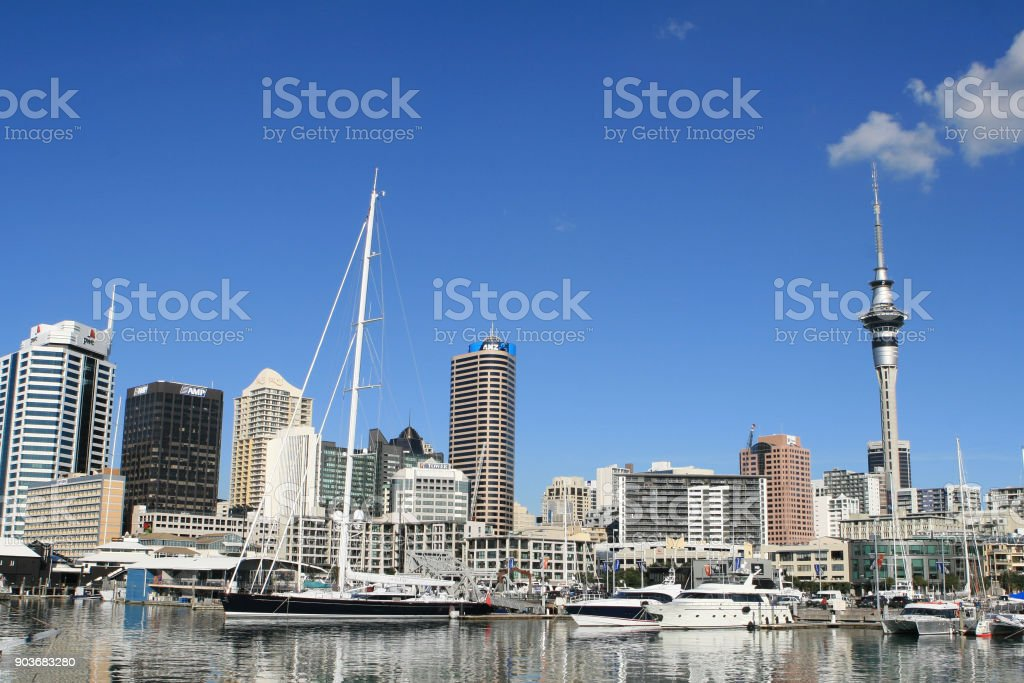 AUCKLAND, NEW ZEALAND - JUNE 14: Auckland skyline. View from the port in Auckland, with buildings, Sky Tower and boats. stock photo
