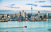 An early morning view of the CBD of Auckland, across the water of Waitemata Harbor.
