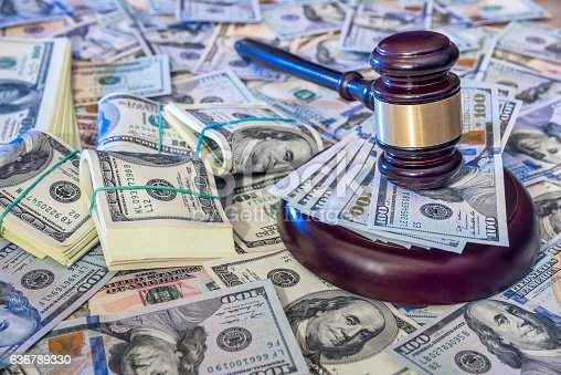 istock Auction concept - judges gavel against us dollar background. 636789330