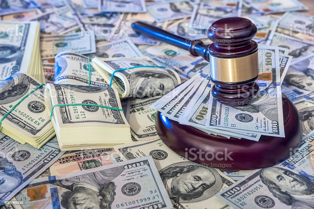 Auction concept - judges gavel against us dollar background. stock photo