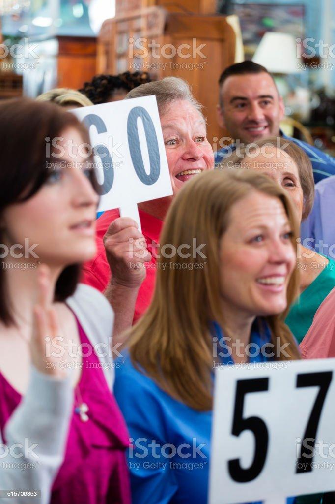 Auction Crowd stock photo