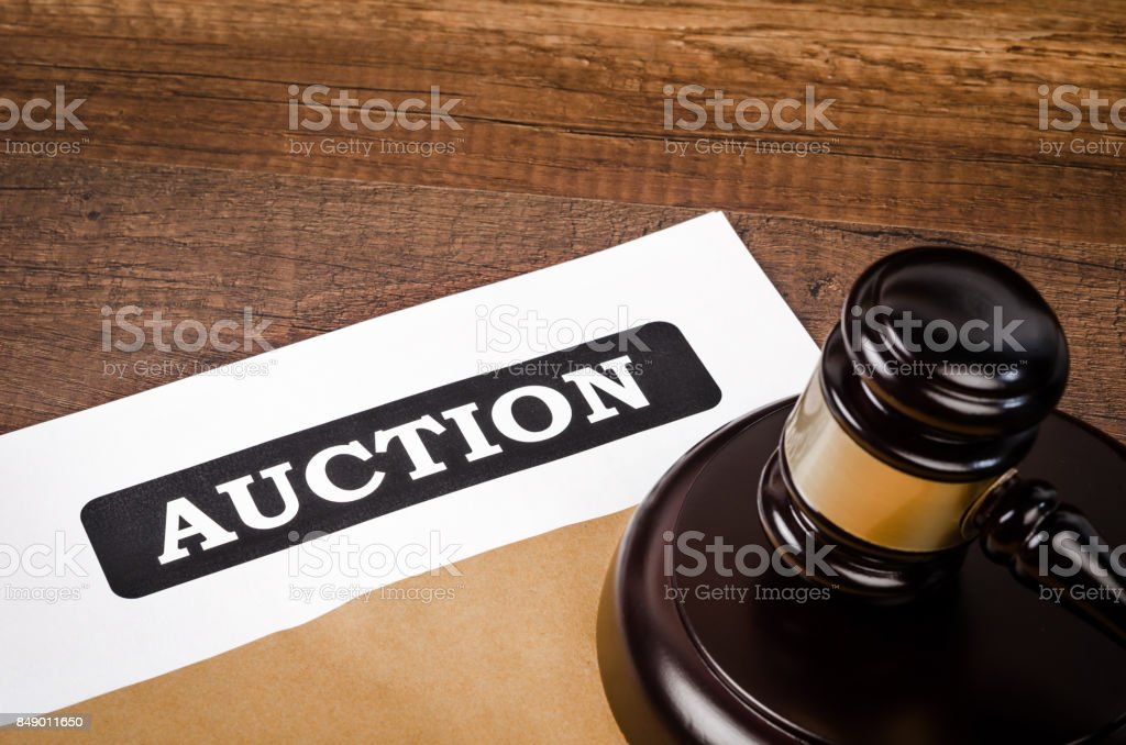 Auction document with wooden gavel. stock photo