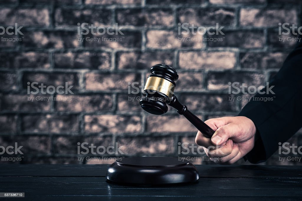 Auction hammer brick background stock photo