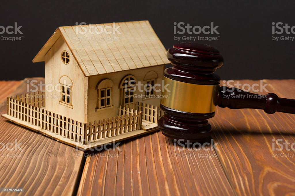 Auction. Law. Miniature House on wooden table and Court Gavel stock photo