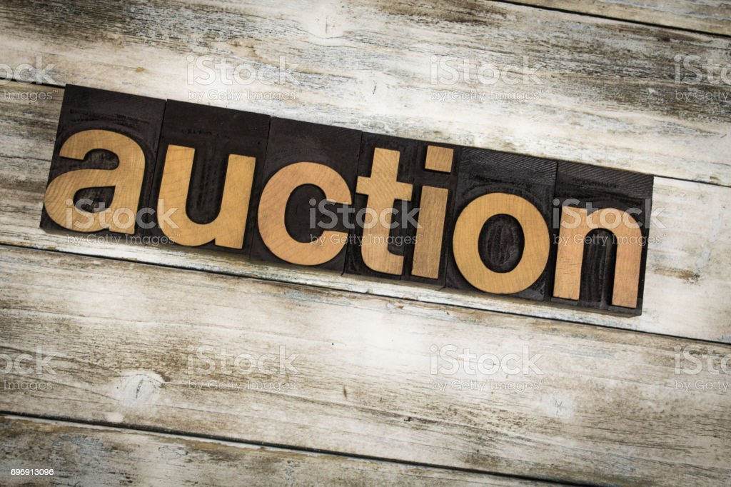 Auction Letterpress Word on Wooden Background stock photo