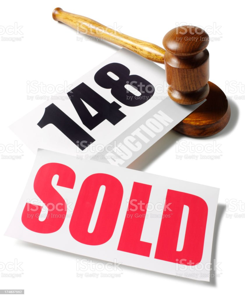 Auction Paddle under the Gavel with a Red Sold Sign stock photo