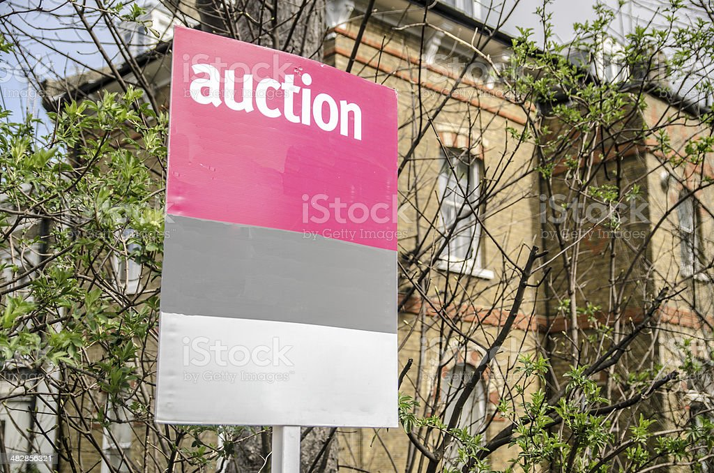 Auction sign with building background stock photo