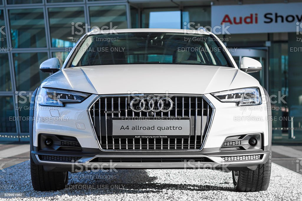 Audi A4 allroad quattro new modern SUV 4WD car model Munich, Germany - May 6, 2016: Audi A4 allroad quattro is new modern SUV car model with four wheel drive system and powerful diesel engine. This outdoor stock photo was captured in a public place with free access. 4x4 Stock Photo