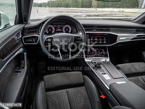 Minsk, Belarus - July 27, 2019: Premium quality interior of Audi A6 55 TFSI Quattro 2019 model year. Interior features three displays which replace regular hard buttons and instrument cluster.