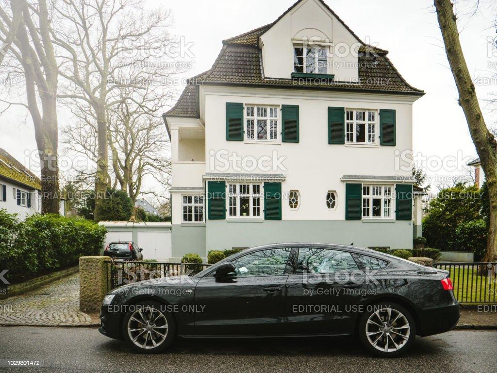 Audi A8 Black car parked near modern house stock photo