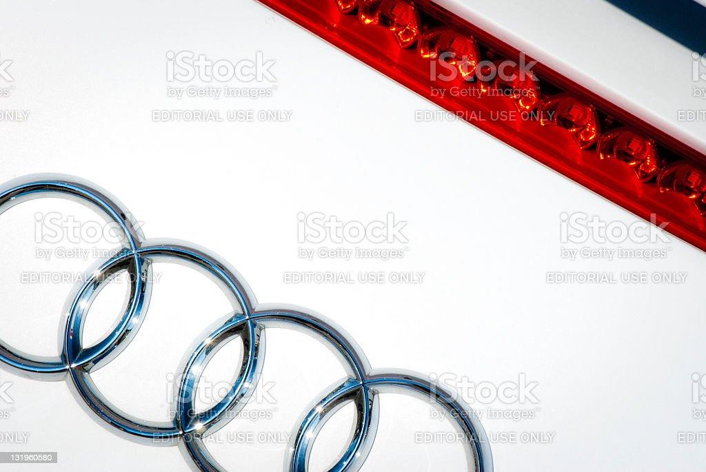 Audi Four Circles Macro Logo on White Car Background stock photo