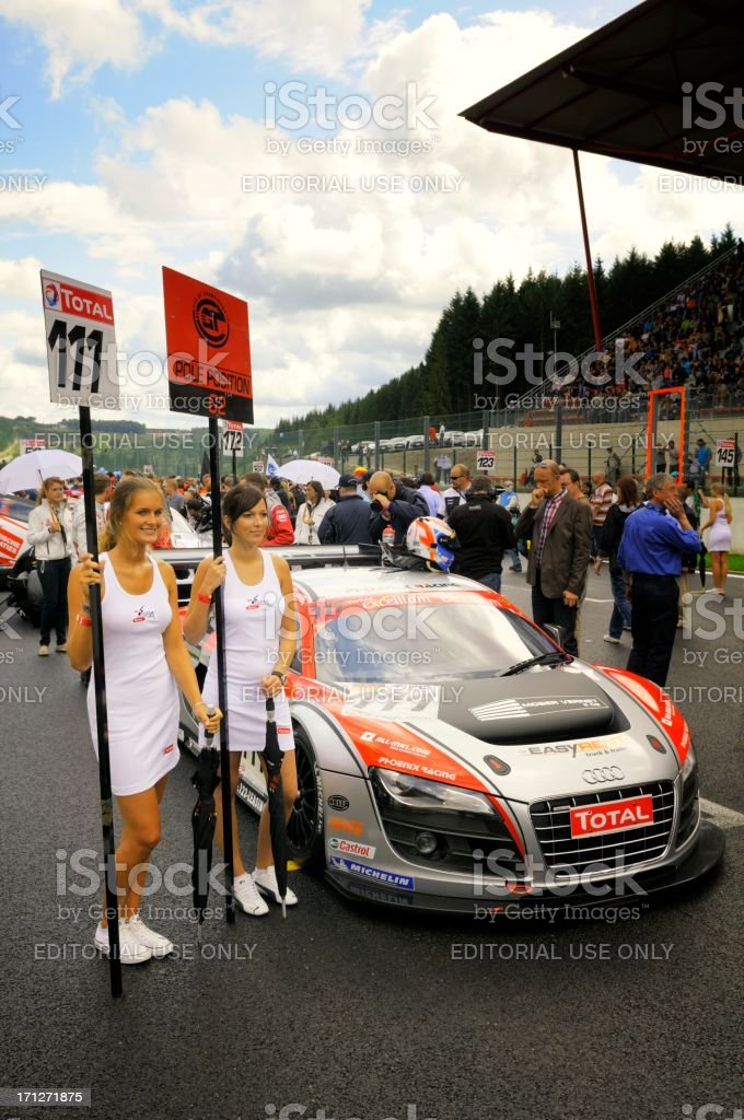 Audi grid girls posing in front of a Audi R8 stock photo