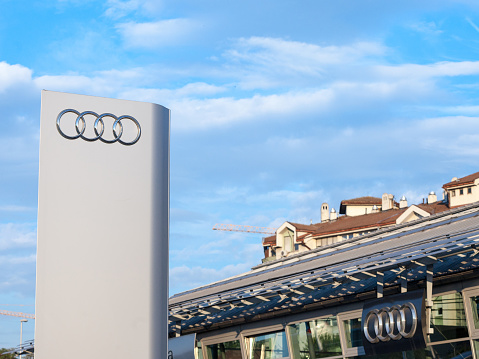istock Audi logo on their main dealership store in Belgrade. Audi is a German car and automotive manufacturer, specialized in luxury sports vehicles 1058816146