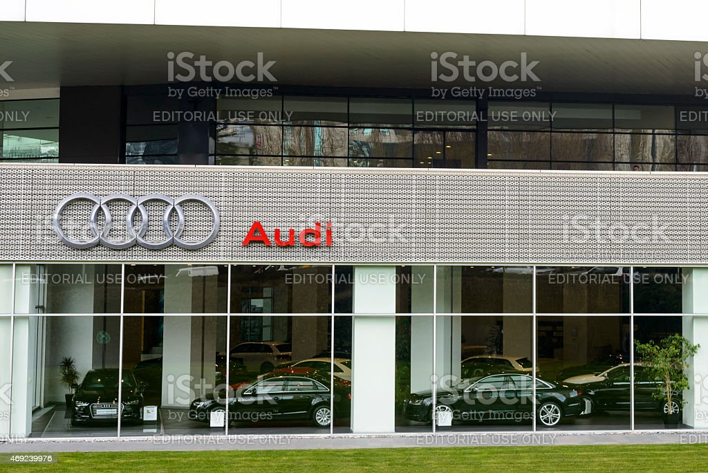 Audi luxury car dealership with various Audi models inside stock photo