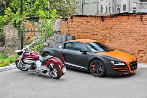 Audi R8 ABT and Honda motorcycle stock photo