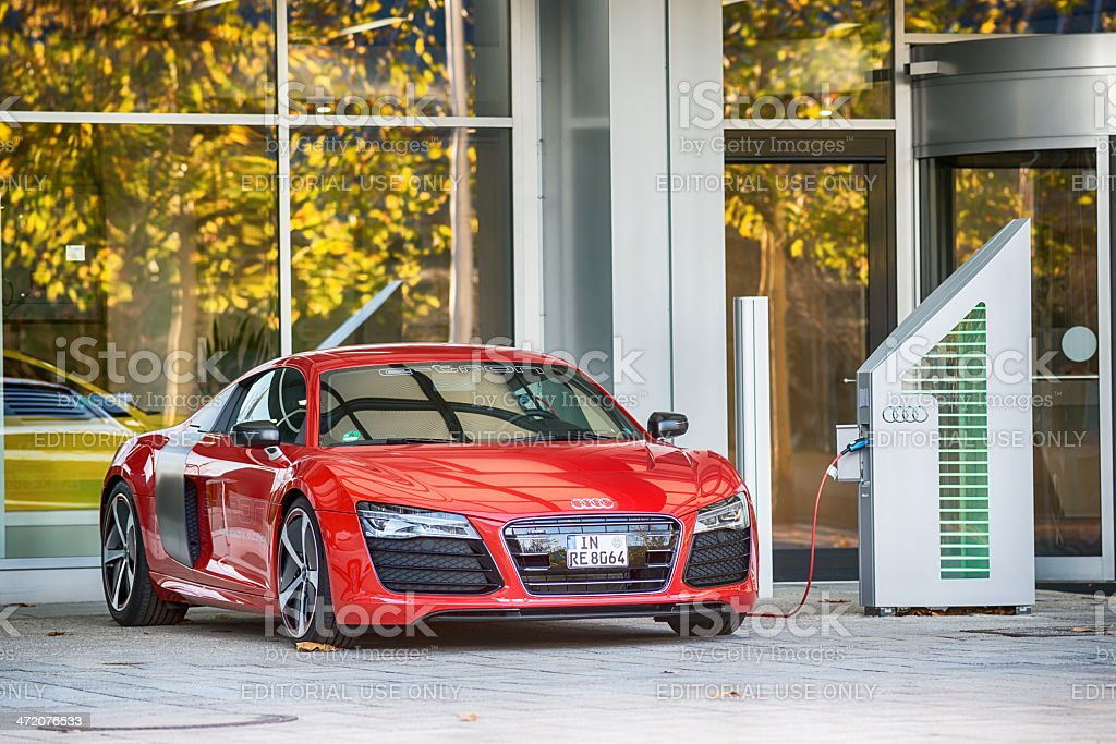 Audi R8 e-tron at charging station. stock photo