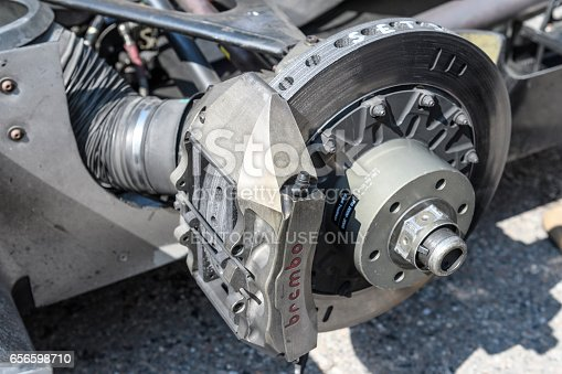 Jüchen, Germany - August 5, 2016: Audi R8 Le Mans Prototype sports-prototype race car brake. The Audi R8 is fitted with a Audi 3.6 liter 90-degree V8 twin-turbo, mid-engine, longitudinally mounted petrol engine. The R8 won Le Mans five times from 2000 onwards and the overall season championship in the American Le Mans Series six times in a row. The car is on display during the 2016 Classic Days event at Schloss Dyck. Classic days is an annual ticketed event on the grounds of Dyck castle.