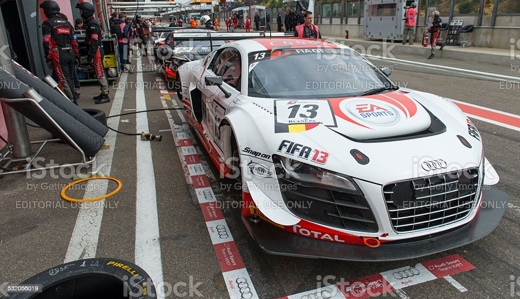 Audi race cars in the pit lane stock photo