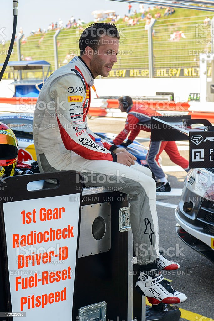 Audi racing driver Anthnoy Kumpen preparing for the race stock photo