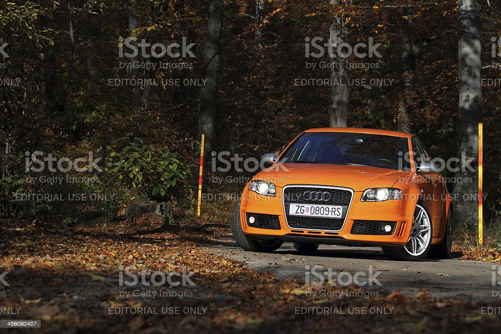 """Audi RS4 """"Zagreb, Croatia - November, 13th 2009: Testing Audi RS4 on a curvy mountain road in autumn. Audi RS4, with 4.2-liter fuel stratified injection V8 engine with 420 hp and quattro permanent four wheel drive, is the highest performing version of Audi A4 range."""" 4x4 Stock Photo"""