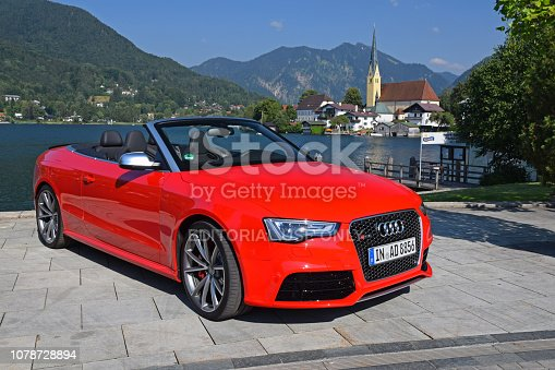 Rottach-Egern, Germany - 2nd July, 2015: Audi RS5 Cabrio parked on the street. The travel in cabriolet vehicle is a big pleasure during the sunny, summer days.