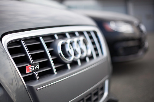 Audi Vehicles At A Car Dealership Stock Photo - Download Image Now