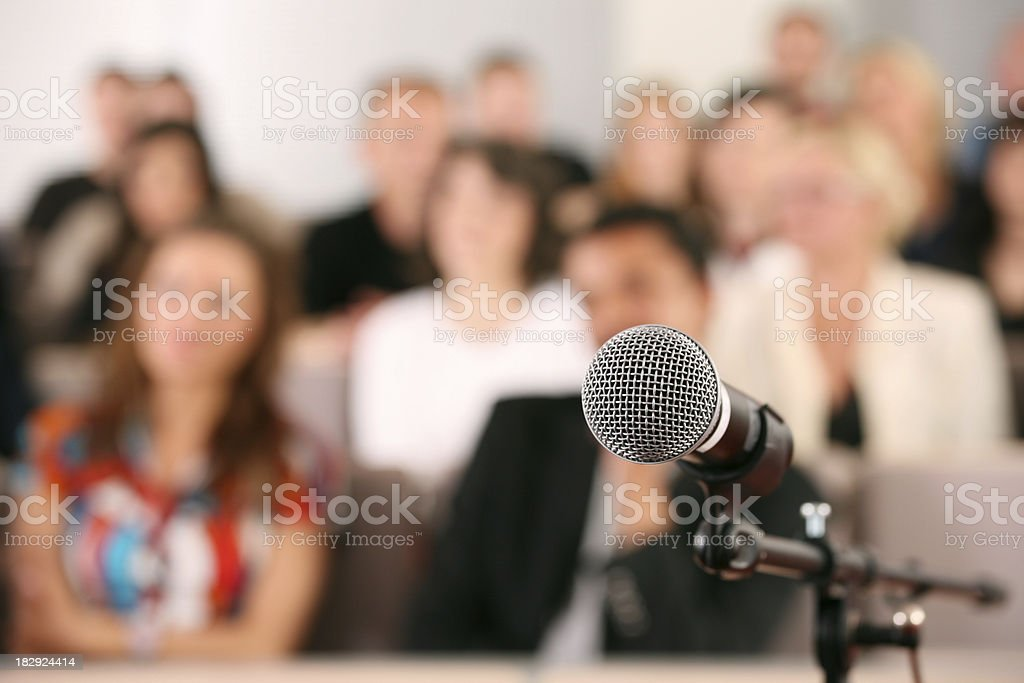 Audience and microphone stock photo