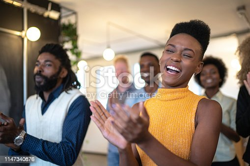 1087253494 istock photo Audience Applauding a Great Speaker at Business convention and Presentation 1147340876