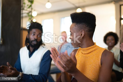1031822210 istock photo Audience Applauding a Great Speaker at Business convention and Presentation 1147376397