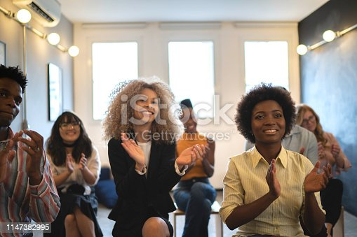 1031822210 istock photo Audience Applauding a Great Speaker at Business convention and Presentation 1147382995