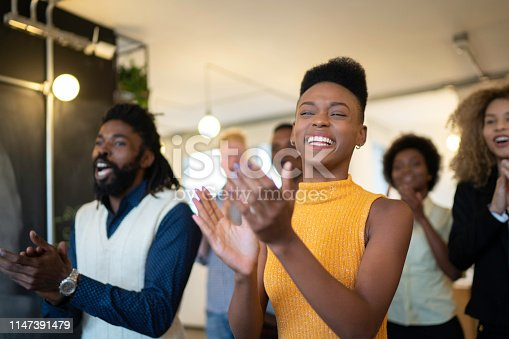 1031822210 istock photo Audience Applauding a Great Speaker at Business convention and Presentation 1147391479