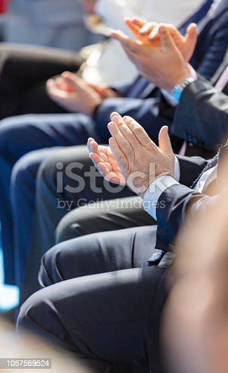 511305456 istock photo Audience applauding after a speech 1057569524